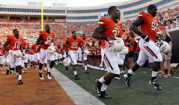 The OSU Cowboys run back underneath the stadium after warming up before a college football game between Oklahoma State University (OSU) and Savannah State University at Boone Pickens Stadium in Stillwater, Okla., Saturday, Sept. 1, 2012. Photo by Nate Billings, The Oklahoman