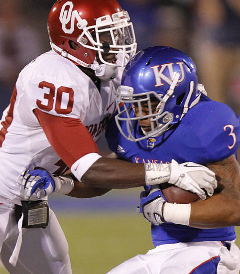 Oklahoma's Javon Harris (30) stops Kansas' Darrian Miller (3) during the college football game between the University of Oklahoma Sooners (OU) and the University of Kansas Jayhawks (KU) on Saturday, Oct. 15, 2011. in Lawrence, Kan. Photo by Chris Landsberger, The Oklahoman
