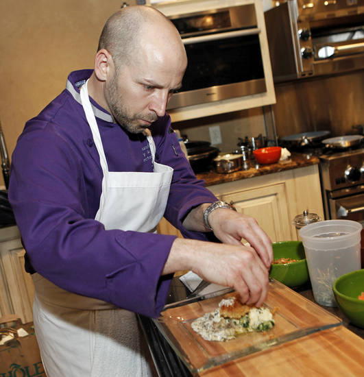 Chef Marc Dunham of Francis Tuttle Culinary School makes his version of chicken fried steak: veal schnitzel with potato gnocchi, morel mushrooms, buttered cabbage, pickled mustard seed and crispy chicken skin, at Culinary Kitchen, 7302 N Western, in Oklahoma City, Monday, March 19, 2012. Photo by Nate Billings, The Oklahoman