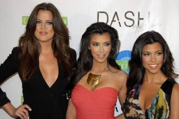 (From left to right) Khloe, Kim and Kourtney Kardashian are seen at the opening of their store in Miami Beach (AP photo)