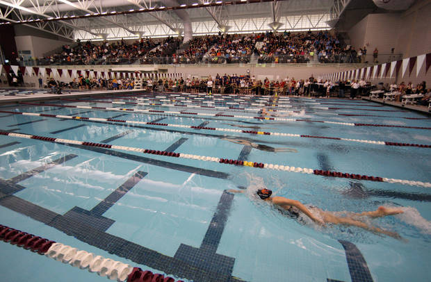 Swimmers swim during the first state meet inside the new Jenks Trojans Aquatics Center, in Jenks, on Saturday, Feb. 16, 2013. CORY YOUNG/Tulsa World ORG XMIT: DTI1302161713268767