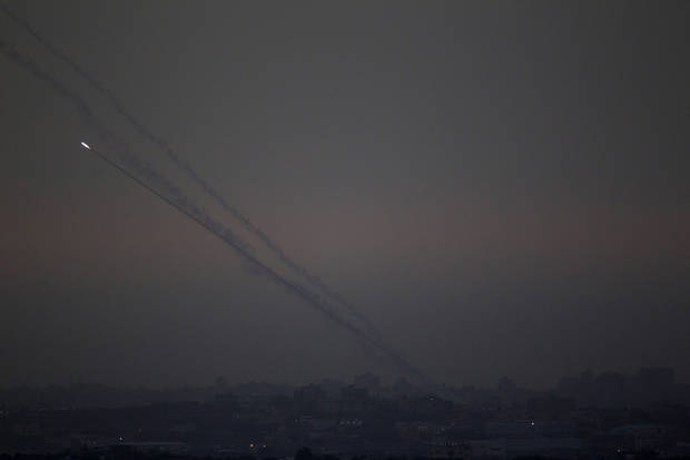 "Rockets lunched by Palestinian militants towards Israel make their way from the northern Gaza Strip, as seen from the Israel Gaza Border, southern Israel, Saturday, Nov. 17, 2012. The Israeli military says its ""Iron Dome"" rocket-defence system has shot down an incoming projectile bound for Tel Aviv. (AP Photo/Ariel Schalit)"