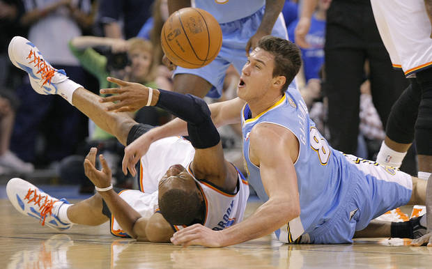 Oklahoma City's Russell Westbrook (0) and Denver's Danilo Gallinari (8) battle for a loose ball during the first round NBA basketball playoff game between the Oklahoma City Thunder and the Denver Nuggets on Sunday, April 17, 2011, in Oklahoma City, Okla. Photo by Chris Landsberger, The Oklahoman ORG XMIT: KOD
