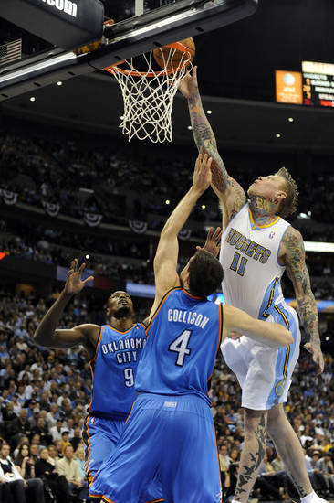 Denver Nuggets center Chris Andersen (11) tips in a basket against Oklahoma City Thunder forward Serge Ibaka (9) from the Republic of Congo and Nick Collison (4) during the second half of game 3 of a first-round NBA basketball playoff series Saturday, April 23, 2011, in Denver. (AP Photo/Jack Dempsey)