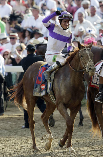 Jockey Mario Gutierrez celebrates after riding I'll Have Another to victory in the 138th Kentucky Derby horse race at Churchill Downs Saturday, May 5, 2012, in Louisville, Ky. (AP Photo/David J. Phillip)  ORG XMIT: DBY193