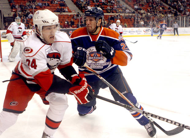 Oklahoma City's Chris VandeVelde defends against Charlotte's Justin Shugg during the AHL game between the Oklahoma City Barons and the Charlotte Checkers at the Cox Convention Center in Oklahoma City, Friday, Feb. 3, 2012. Photo by Sarah Phipps, The Oklahoman ORG XMIT: KOD