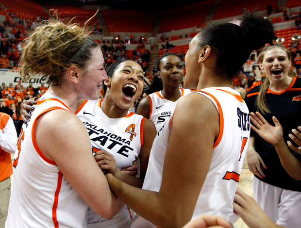 Oklahoma State players, from left, Lindsey Keller, Tiffany Bias, Toni Young and Kendra Suttles celebrate their victory in an NCAA college basketball game against Oklahoma in Stillwater, Okla., Saturday, Jan. 14, 2012. Photo by Sarah Phipps/The Oklahoman