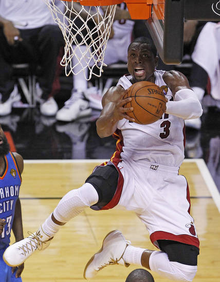 Miami Heat shooting guard Dwyane Wade (3) shoots against the Oklahoma City Thunder during the first half at Game 3 of the NBA Finals basketball series, Sunday, June 17, 2012, in Miami. (AP Photo/Wilfredo Lee) ORG XMIT: NBA124
