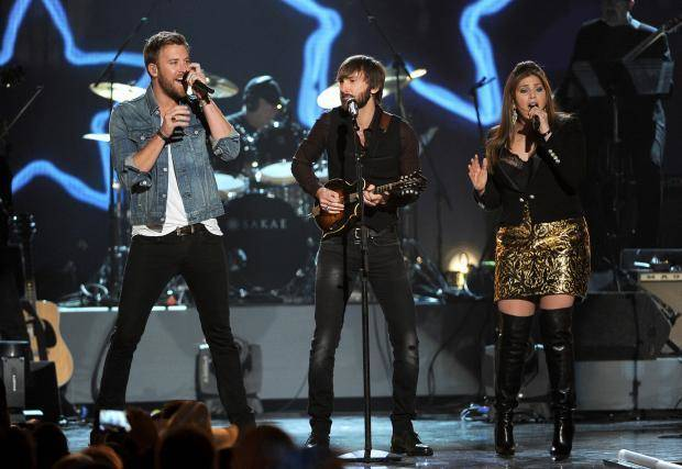"Charles Kelley, and from left, Dave Haywood and Hillary Scott, of the musical group Lady Antebellum, perform at ""ACM Presents an All-Star Salute to the Troops"" on Monday, April 7, 2014, in Las Vegas. (AP)"