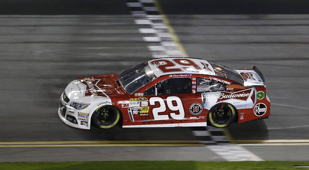 Kevin Harvick crosses the finish line to win the NASCAR Sprint Unlimited auto race at Daytona International Speedway, Saturday, Feb. 16, 2013, in Daytona Beach, Fla. (AP Photo/John Raoux)