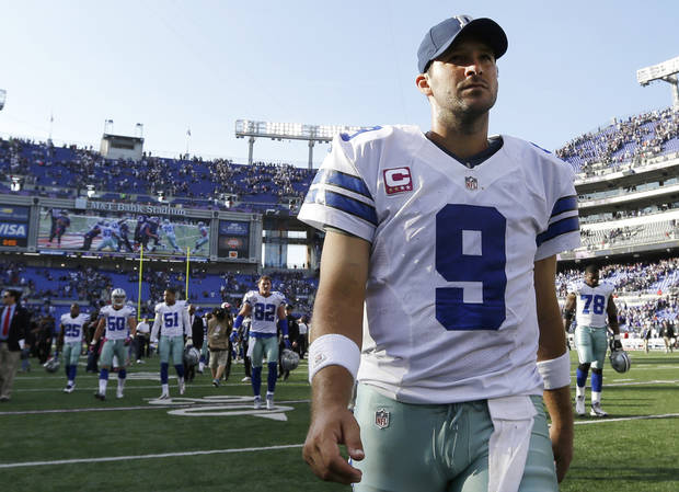 Dallas Cowboys quarterback Tony Romo walks off the field after an NFL football game against the Baltimore Ravens in Baltimore, Sunday, Oct. 14, 2012. Baltimore won 31-29. (AP Photo/Patrick Semansky) ORG XMIT: BAF126