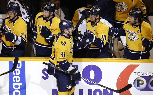 Nashville Predators center Colin Wilson (33) is congratulated after scoring against the Los Angeles Kings in the second period of an NHL hockey game, Thursday, Feb. 7, 2013, in Nashville, Tenn. (AP Photo/Mark Humphrey)