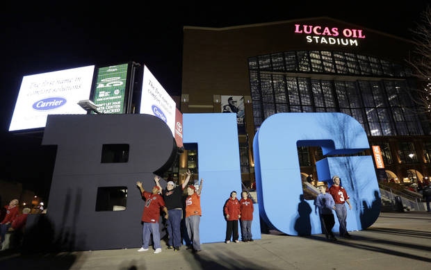 Fans pose for photos outside of Lucas Oil Stadium before the Big Ten Conference championship NCAA college football game between Wisconsin and Nebraska, Saturday, Dec. 1, 2012, in Indianapolis. (AP Photo/AJ Mast)  ORG XMIT: NAS101