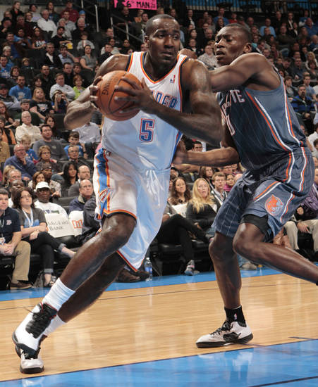 Oklahoma City Thunder's Kendrick Perkins (5) drives to the basket guarded by Charlotte Bobcats' Bismack Biyombo (0) during the NBA basketball game between the Oklahoma City Thunder and the Charlotte Bobcats at Chesapeake Energy Arena in Oklahoma City, Saturday, March 10, 2012. Photo by Steve Sisney, The Oklahoman