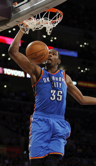 Oklahoma City's Kevin Durant (35) dunks the ball during Game 4 in the second round of the NBA basketball playoffs between the L.A. Lakers and the Oklahoma City Thunder at the Staples Center in Los Angeles, Saturday, May 19, 2012. Photo by Nate Billings, The Oklahoman