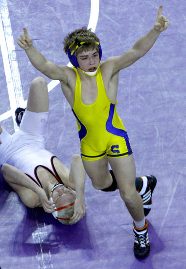 Stillwater's Joe Smith celebrates over a dejected Boo Lewallen following the Class 6A 113-pound match during the state wrestling championships at the State Fair Arena in Oklahoma City, Saturday, Feb. 25, 2012. Photo by Sarah Phipps, The Oklahoman