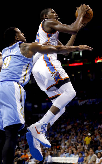 Oklahoma City's Kevin Durant (35) shoots as Denver's Andre Iguodala (9) defends during the NBA preseason basketball game between the Oklahoma City Thunder and the Denver Nuggets at the Chesapeake Energy Arena, Sunday, Oct. 21, 2012. Photo by Sarah Phipps, The Oklahoman