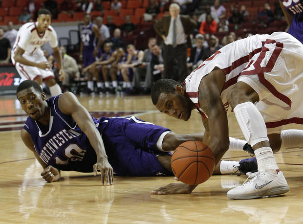 Northwestern's Patrick Robinson (10) and Oklahoma's Amath M'Baye (22) fight for a ball during a men's college basketball game between the University of Oklahoma and Northwestern Louisiana State University at the Lloyd Noble Center in Norman, Okla., Friday, Nov. 30, 2012.  Photo by Garett Fisbeck, The Oklahoman