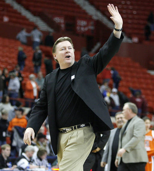 OSU coach Kurt Budke waves to the crowd after OSU's win in the Big 12 Women's Championships game between Oklahoma State University and Texas Tech at the Cox Convention Center in Oklahoma City, Thursday, March 12, 2009.  PHOTO BY BRYAN TERRY, THE OKLAHOMAN