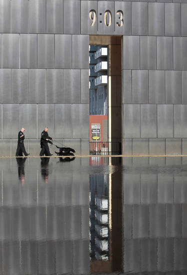 Police use a bomb sniffing dog by the reflecting pool before the 18th Anniversary Remembrance Ceremony at the Oklahoma City National Memorial and Museum, Friday, April 19, 2013. Photo By David McDaniel/The Oklahoman