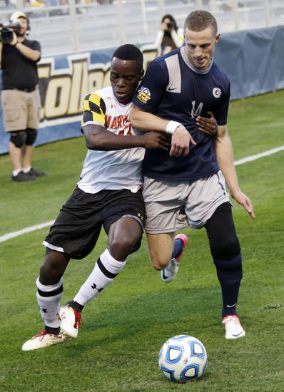 Maryland's Schillo Tshuma, left, and Georgetown's Cole Seiler battle for the ball in the first half of a NCAA College Cup men's championship semifinal soccer match at Regions Park, Friday, Dec. 7, 2012, in Hoover, Ala. (AP Photo/Dave Martin)