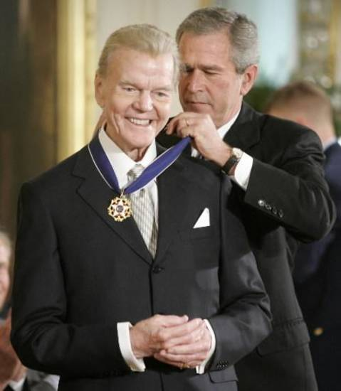 President George W.Bush awards radio commentator Paul Harvey, the Presidential Medal of Freedom Award in the East Room of the White House, Wednesday, Nov. 9, 2005, in Washington. The Presidential Medal of Freedom is the nation's highest civilian award, and recognizes exceptional meritorious service. (AP file)