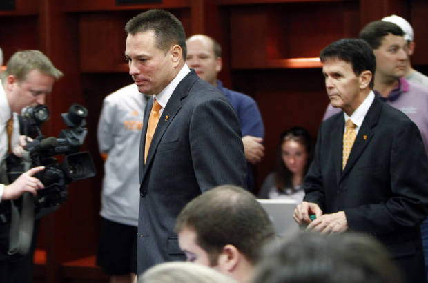 Butch Jones, left,Tennessee's new head football coach, followed by Tennessee Athletics Director Dave Hart, walks to address the media during an NCAA college football new conference on Friday, Dec. 7, 2012, in Knoxville, Tenn. The Vols' introduced Jones on Friday as its successor to Derek Dooley, who was fired Nov. 18 after going 15-21 in three seasons. (AP Photo/Wade Payne)