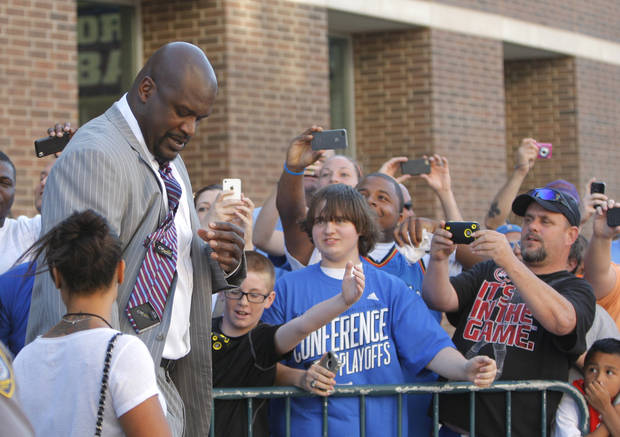 Fans watch Shaq O'Neal walk to the TNT set game three of the Western Conference Finals in the NBA playoffs between the Oklahoma City Thunder and the San Antonio Spurs at Chesapeake Energy Arena in Oklahoma City, Thursday, May 31, 2012. Photo by Sarah Phipps, The Oklahoman