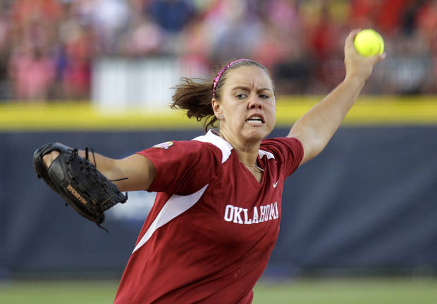 FILE - In this June 5, 2012, file photo, Oklahoma's Keilani Ricketts pitches against Alabama in the fourth inning of an NCAA Women's College World Series softball game in Oklahoma City.  Bama and runner-up Oklahoma are among the favorites to once again contend for the Women's College World Series in a sport that's more wide open than ever.(AP Photo/Sue Ogrocki, File) ORG XMIT: OKSO203