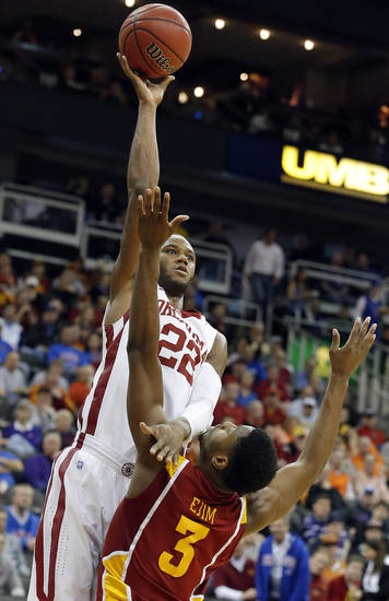 Oklahoma's Amath M'Baye (22) shoots over Iowa State's Melvin Ejim (3) during the Phillips 66 Big 12 Men's basketball championship tournament game between the University of Oklahoma and Iowa State at the Sprint Center in Kansas City, Thursday, March 14, 2013. Photo by Sarah Phipps, The Oklahoman
