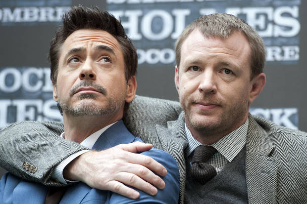 "U.S. actor Robert Downey Jr, left, and British director Guy Ritchie present the movie ""Sherlock Holmes: A Game of Shadows"", in Rome, Sunday, Dec. 11, 2011. (AP Photo/Virginia Farneti, Lapresse) ORG XMIT: ROM803"