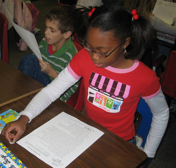 "Matthew Johnson and Camille Burge, both 4th grade students at Soldier Creek Elementary, read aloud during the Walden Media's ""Break a World Reading Record with Charlotte's Web.""<br/><b>Community Photo By:</b> Stacey Boyer<br/><b>Submitted By:</b> Stacey, Midwest City"