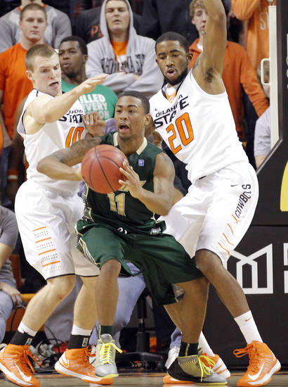 Oklahoma State 's Phil Forte (10) and Michael Cobbins (20) defend on South Florida Bulls' Anthony Collins (11) during the college basketball game between Oklahoma State University (OSU) and the University of South Florida (USF) on Wednesday , Dec. 5, 2012, in Stillwater, Okla.   Photo by Chris Landsberger, The Oklahoman