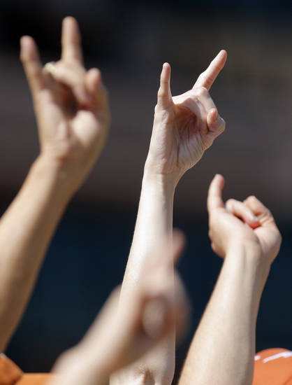 Texas fans make the Hook 'em Horns gesture in the first half during a college football game between the Oklahoma State University Cowboys (OSU) and the University of Texas Longhorns (UT) at Darrell K Royal-Texas Memorial Stadium in Austin, Texas, Saturday, Oct. 15, 2011. Photo by Nate Billings, The Oklahoman