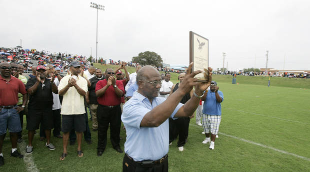 Former Millwood head football coach Leodies Robinson holds a plaque during a halftime ceremony naming the football field after the legendary coach at Millwood High school in Oklahoma City, Oklahoma September 12, 2009. Photo by Steve Gooch, The Oklahoman