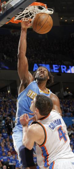 Denver's Nene (31) dunks the ball over Oklahoma City's Nick Collison (4) during the first round NBA playoff game between the Oklahoma City Thunder and the Denver Nuggets on Sunday, April 17, 2011, in Oklahoma City, Okla. Photo by Chris Landsberger, The Oklahoman