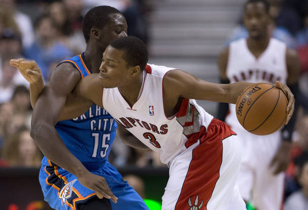 Toronto Raptors guard Kyle Lowry (3) is fouled by Oklahoma City Thunder guard Reggie Jackson (15) during first-quarter NBA basketball game action in Toronto, Sunday, Jan.6, 2013. (AP Photo/The Canadian Press, Frank Gunn) ORG XMIT: FNG108