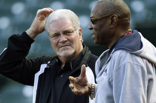 San Francisco Giants general manager Brian Sabean, left, listens to Cincinnati Reds manager Dusty Baker during batting practice in preparation for Game 1 of the National League division baseball series, Thursday, Oct. 4, 2012, in San Francisco. (AP Photo/Ben Margot)