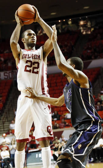 Oklahoma&#039;s Amath M&#039;Baye (22) shoots against TCU&#039;s Connell Crossland (2) during an NCAA men&#039;s basketball game between the University of Oklahoma (OU) and Texas Christian University (TCU) at the Lloyd Noble Center in Norman, Okla., Monday, Feb. 11, 2013. OU won, 75-48. Photo by Nate Billings, The Oklahoman
