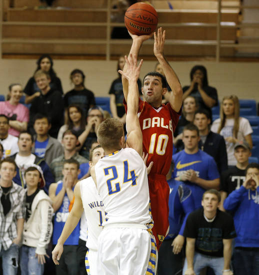 Dale's Jace Wilkins shoots the ball over Bethel's Andrew Kinnamon during their boys high school basketball game at Bethel High School in Shawnee, Okla., Friday, Feb. 1, 2013. Photo by Bryan Terry, The Oklahoman