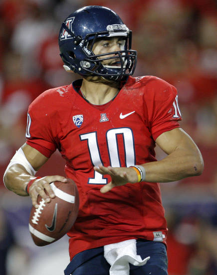 Arizona's Matt Scott (10) looks to throw a pass during the college football game between the University  of Arizona and Oklahoma State University at Arizona Stadium in Tucson, Ariz.,  Saturday, Sept. 8, 2012. Photo by Sarah Phipps, The Oklahoman