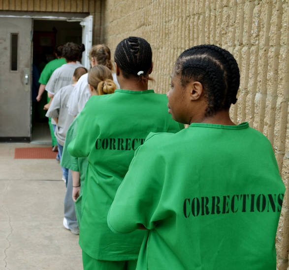 Inmates line up for lunch outside the cafeteria at Hillside Community Corrections Center in Oklahoma City Monday, March 16, 2012. Photo by Zeke Campfield, The Oklahoman