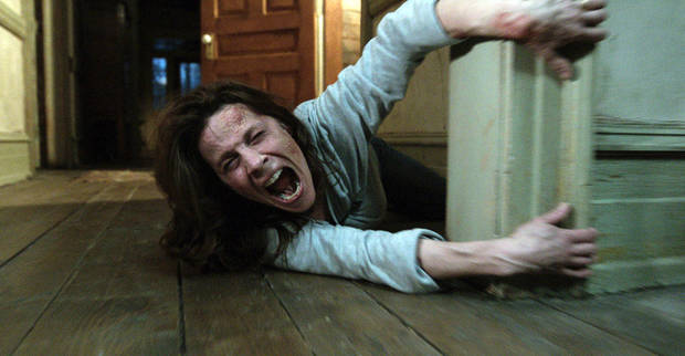 "In this publicity image released by Warner Bros. Pictures, Lili Taylor portrays Carolyn Perron in a scene from ""The Conjuring."" The film opens nationwide on Friday, July 19. (AP Photo/New Line Cinema/Warner Bros. Pictures) ORG XMIT: CAPH247"
