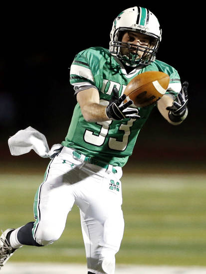 Irish running back Danny Krenger catches a pass in the first half as the Bishop McGuinness Irish play the Carl Albert Titans in a Class 5A semi-final playoff game at Harve Collins Field on Friday, Nov. 23, 2012  in Norman, Okla. Photo by Steve Sisney, The Oklahoman