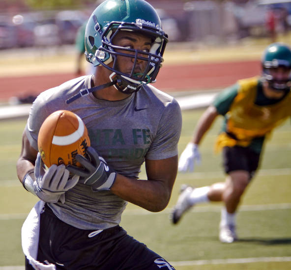 Edmond Santa Fe football players take to the field during the first day of football practice at Edmond Santa Fe High School on Tuesday, Aug. 7, 2012, in Edmond, Okla.  Photo by Chris Landsberger, The Oklahoman