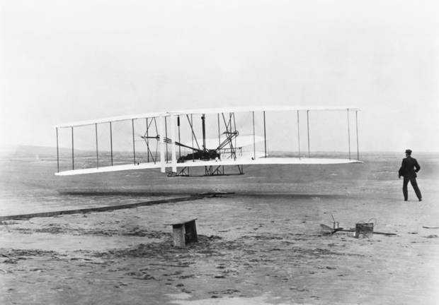 "The National Archives preserves and protects photos of the nation's history, like this one of the Wright Brothers' original 1903 Aeroplane ""Kitty Hawk"" during its first flight, with Orville Wright at the controls. Preserving and displaying historical electronic records sometimes is more difficult. PHOTO PROVIDED. <strong></strong>"