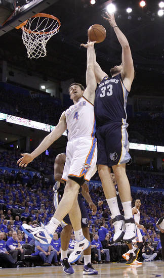 Oklahoma City's Nick Collison (4) battles under the basket with Marc Gasol (33) of Memphis during game two of the Western Conference semifinals between the Memphis Grizzlies and the Oklahoma City Thunder in the NBA basketball playoffs at Oklahoma City Arena in Oklahoma City, Tuesday, May 3, 2011. Photo by Chris Landsberger, The Oklahoman