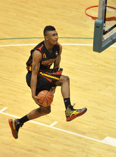 LeBryan Nash competes in the slam dunk contest at the McDonald's High School All American basketball Jam Fest at Chicago State University in Chicago, Monday, March 28, 2011. Nash won the contest. (AP Photo/Brian Kersey)