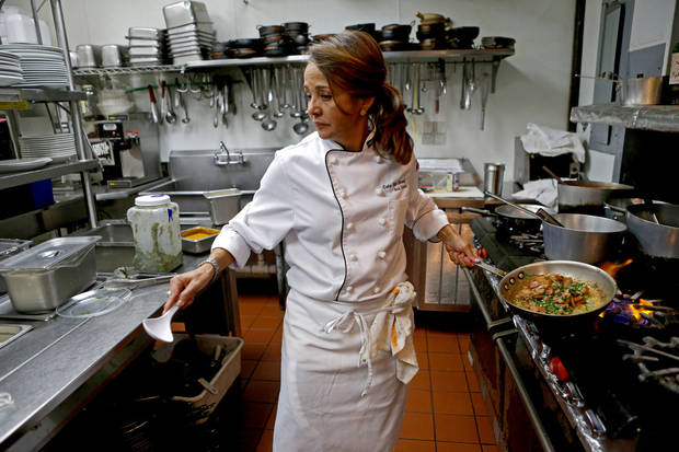 Chef Ana Davis prepares a dish at Cafe Do Brasil. Photo by Bryan Terry, The Oklahoman <strong>BRYAN TERRY - THE OKLAHOMAN</strong>