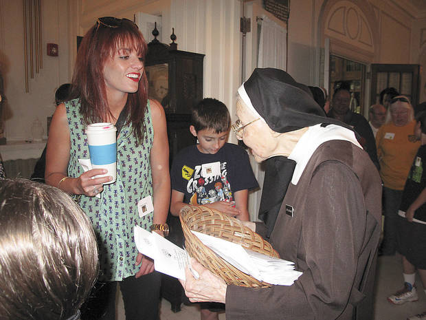 Emily Scott of Oklahoma City visits with Sister Joseph Marie Gibbons foyer of Villa Teresa Convent during the recent Carmelite Sisters of St. Therese's 95th anniversary celebration at the convent and Villa Teresa School in Oklahoma City.  Photo by Carla Hinton, The Oklahoman